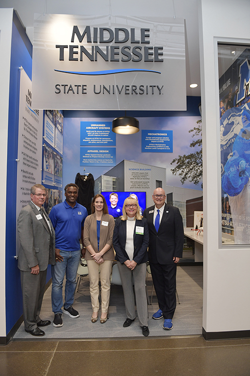 MTSU representatives are shown Tuesday, Jan. 14, at the grand opening of the new JA Finance Park on Powell Place in Nashville, Tenn. Pictured, from left, are Joe Bales, vice president for university advancement; MTSU Trustee and Vice Chairman Darrell Freeman Sr.; Sherry Wiser George, graphic artist with MTSU Creative Marketing Solutions; MTSU alumna, trustee and Junior Achievement of Middle Tennessee board member Pam Wright; and Andrew Oppmann, vice president for marketing and communications. The new park by Junior Achievement of Middle Tennessee provides a real-world simulation for students to learn how their financial decisions regarding higher education, health care and other areas affect their personal budgets. Wright funded an MTSU-branded room in the park that features popular university programs. (MTSU photo by James Cessna)