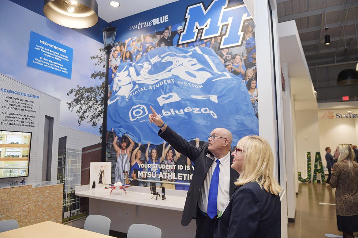 MTSU alumna, trustee and Junior Achievement of Middle Tennessee board member Pam Wright, right, chats with MTSU's Andrew Oppmann, vice president for marketing and communications, Tuesday, Jan. 14, at the grand opening of the new JA Finance Park on Powell Place in Nashville, Tenn. The new park provides a real-world simulation for students to learn how their financial decisions regarding higher education, health care and other areas affect their personal budgets. Wright, a longtime JA supporter, funded an MTSU-branded room in the park that features popular university programs. (MTSU photo by James Cessna)