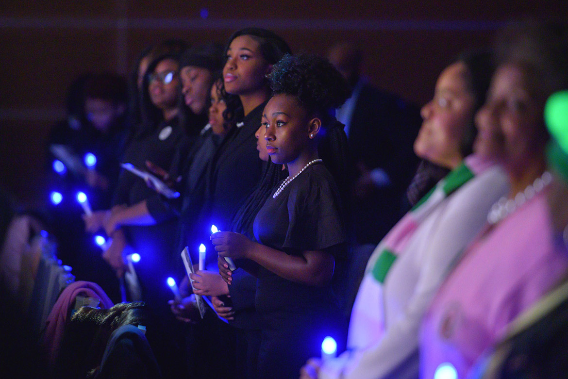 MTSU students and attendees hold their electronic candles during a moment of reflection Monday, Jan. 20, at the 2020 Martin Luther King Jr. Day Candlelight Vigil hosted by Middle Tennessee State University inside the Student Union Ballroom. (MTSU photo by Cat Curtis Murphy)