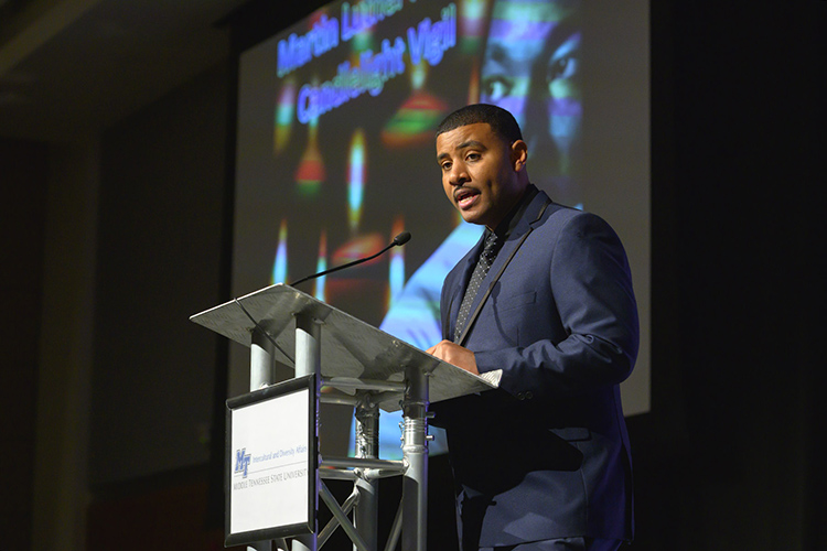 Daniel Green, director of MTSU's Office of Intercultural and Diversity Affairs, serves as emcee Monday, Jan. 20, at the 2020 Martin Luther King Jr. Day Candlelight Vigil hosted by Middle Tennessee State University inside the Student Union Ballroom. (MTSU photo by Cat Curtis Murphy)