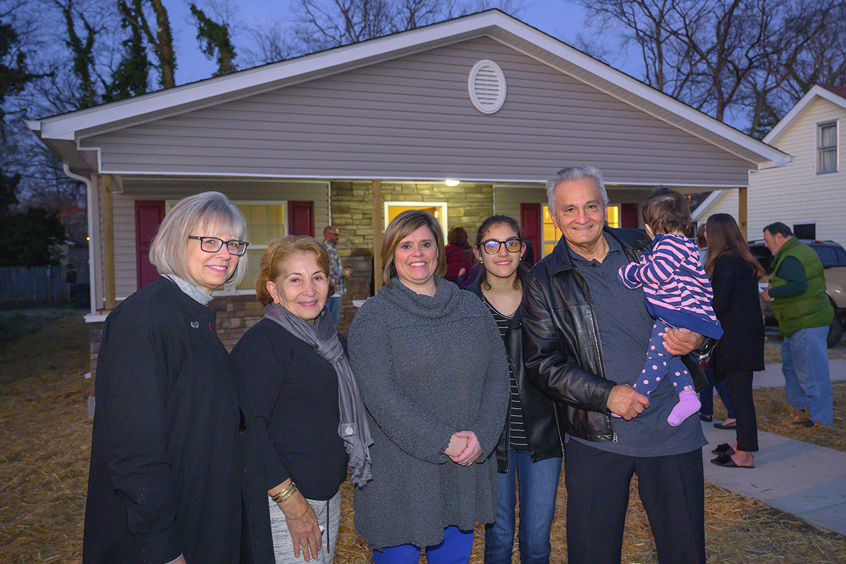 MTSU officials helped celebrate the dedication of a new Rutherford County Area Habitat for Humanity home with the new homeowners Wednesday, Jan. 8, on East Castle Street in Murfreesboro. Shown are MTSU's Deb Sells, left, Rafela Aldas, MTSU's Jackie Victory, granddaughter Arianna Quinones, 13, Carlos Rivero-Odermatt and granddaughter Annabella Roque Rivero, 1. MTSU student volunteers helped with the build last fall. (MTSU photo by Cat Curtis Murphy)