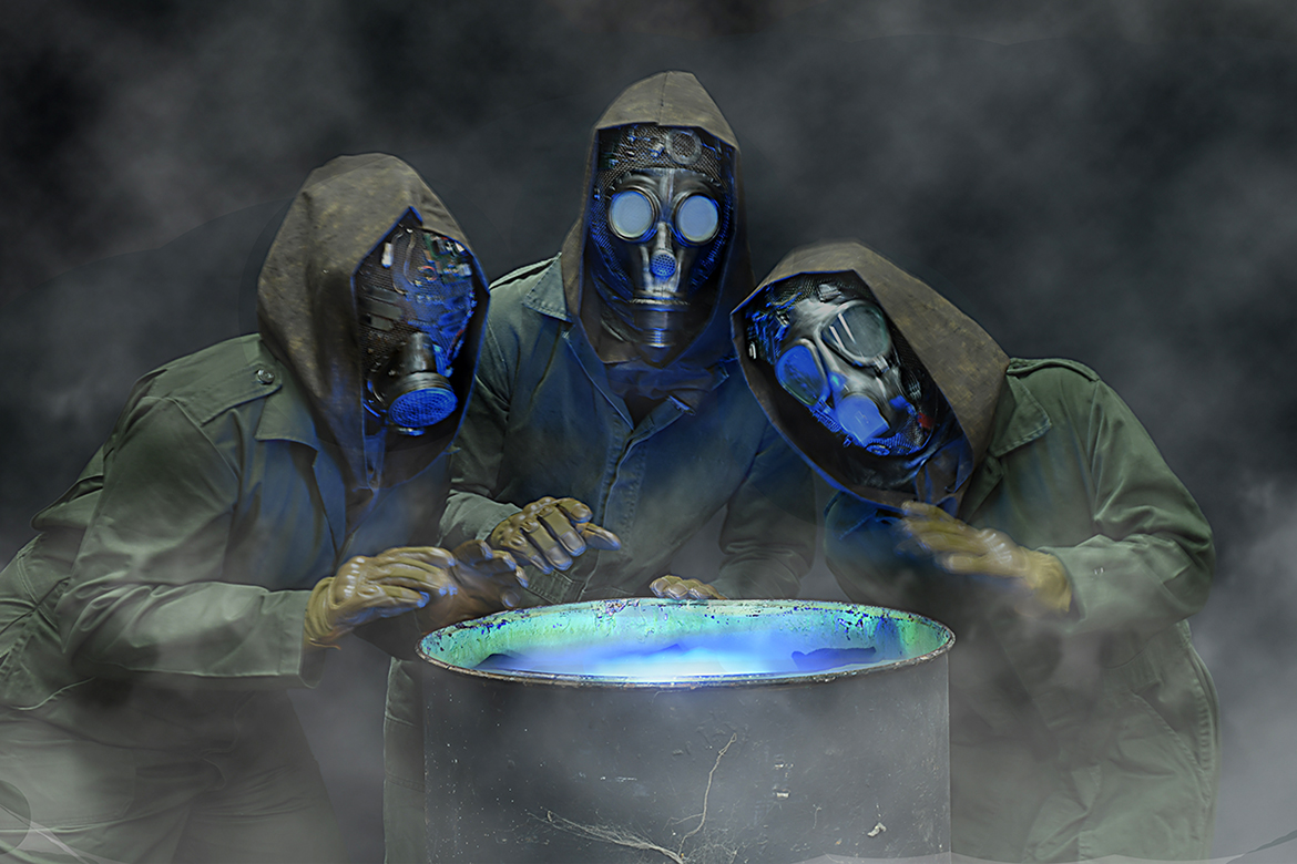 A trio of gas-mask-wearing witches, including MTSU theatre alumna Delaney Keith, right, brew up a fog most foul and filthy air in the Nashville Shakespeare Festival's new production of