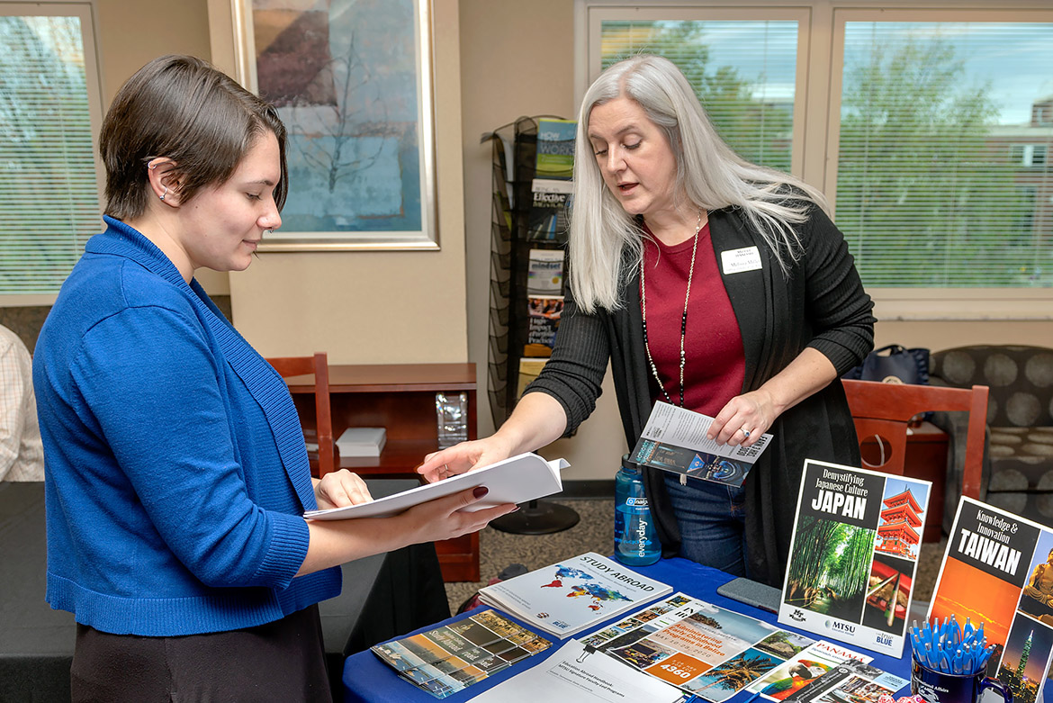 Melissa Miller, right, director of the Office of Education Abroad, explains study abroad courses to master's degree candidate Jeanette Stevens of the Career Development Center at the Learning, Teaching and Innovative Technology Center in October 2019. (MTSU photo by James Cessna)