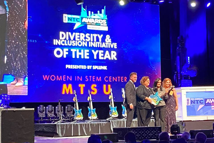 MTSU Women in STEM Center board members Lisa Reaney, center left, an aerospace alumna, andShruti Sharma, an engineer with Ingram Content Group, accept the prized guitar representing the Nashville Technology Council Award for the Diversity and Inclusion Initiative of Year at the organization's Jan. 23 ceremony at the Wildhorse Saloon in downtown Nashville, Tenn. (Submitted photo)