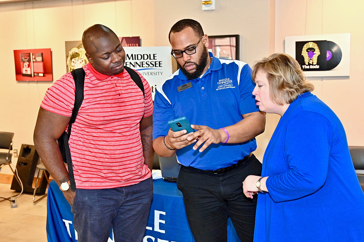 "As a Nashville State Community College student in February 2019, Dravidi Pasha, left, receives advice about transferring from MTSU transfer coordinators Zach Thompson and Jeana Nier. Pasha is a senior in the Jones College of Business. The ""MTSU Promise Tour runs from Jan. 28 through Feb. 13 at nine community colleges. MTSU takes its ""True Blue Pathway"" event to Nashville State's main campus Feb. 4. (MTSU file photo by Andy Heidt)"