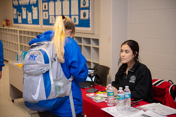 Taylor Hatch, left, a senior exercise science major, looks over her information before donating blood while senior nursing major Anna Meador sits ready to help Feb. 10 in MTSU's Keathley University Center during the university's 2020 valentine blood drive. (MTSU photo by James Cessna)