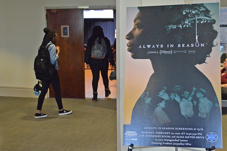 "MTSU students enter the James Union Building's Tennessee Room for the Feb. 10 screening of the documentary ""Always in Season."" (MTSU photo by Jimmy Hart)"
