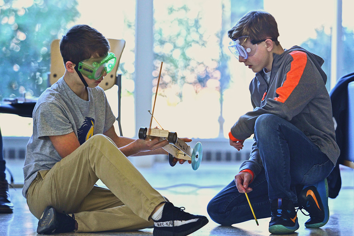 Dayspring Academy eighth-graders Erik Furdui, left and Will Cordle give their Mousetrap Vehicle entry another look during the 25th annual Regional Science Olympiad at MTSU Saturday, Feb. 22, in the Science Building. The Greenbrier, Tenn., school qualified for the State Science Olympiad, which will be held April 25 in Knoxville, Tenn. (MTSU photo by Cat Curtis Murphy)
