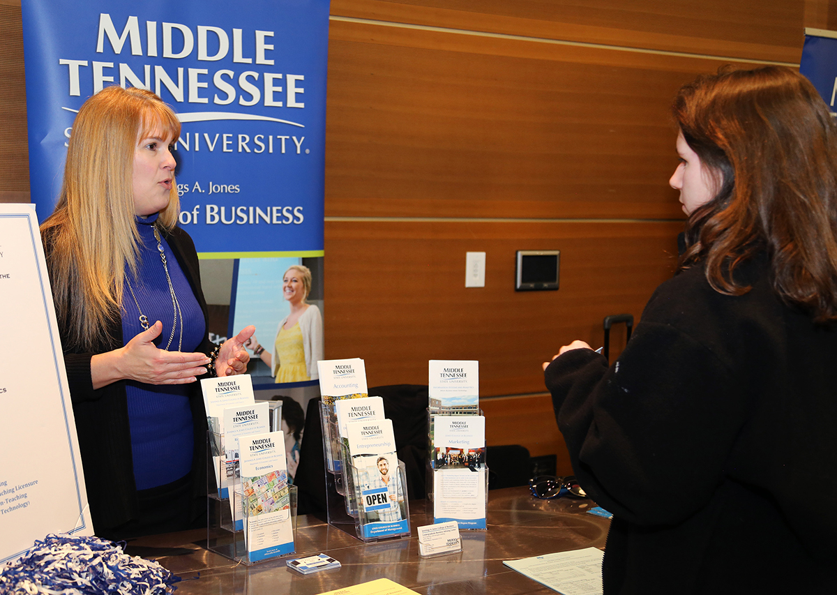 Jones College of Business advising manager Gretchen Leming, left, answers questions from a prospective student Monday, Feb. 17, during the annual MTSU Honors College Presidents Day Open House in the Student Union Ballroom. Nearly 250 students, plus their parents, attended the all-day event. (MTSU photo by Marsha Powers)