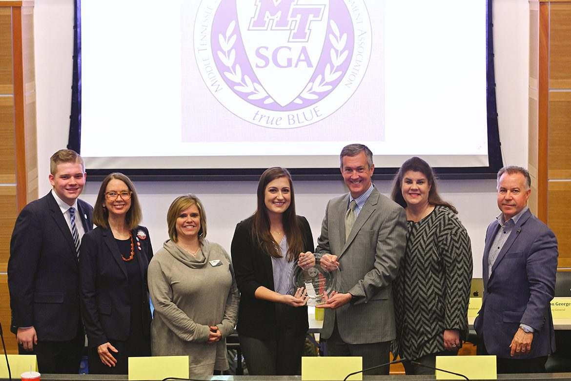 Tennessee Secretary of State Tre Hargett, third from right, presents the 2019 Tennessee College Voter Registration Competition award for the state's four-year universities to MTSU Student Government Association President Delanie McDonald on Thursday, Feb.12, in the MTSU Student Union Parliamentary Room. Pictured, from left, are MTSU SGA Attorney General Preston George; Mary A. Evins, an associate research professor and coordinator for the MTSU chapter of the American Democracy Project; Jackie Victory, director of student organizations and service in the MTSU Center for Student Involvement and Leadership; McDonald; Hargett; state Sen. Dawn White of Murfreesboro, Tenn.; and state Rep. Mike Sparks of Smyrna, Tenn. (MTSU photo by Cat Curtis Murphy)