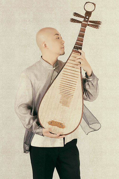 "Artist and educator Jun Tian, professor at the School of Arts of the North University of China and a visiting artist at MTSU, poses with his pipa, a four-string, pear-shaped lute with its origins in ancient Persia and China, in this publicity photo. Tian will perform ""Reflections: Clouds and Blossoms,"" a concerto by award-winning contemporary composer Danhong Wang, with the MTSU Symphony Orchestra Saturday, Feb. 29, in a free public concert in the university's Wright Music Building. (photo submitted)"