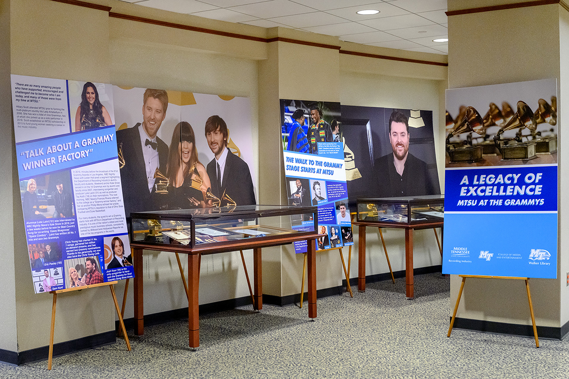 "Some of the MTSU connections for the annual Grammy Awards are shown in posters on display in an exhibit at the university's James E. Walker Library, ""A Legacy of Excellence: MTSU at the Grammys,"" through the end of February. Alongside display cases with Grammy memorabilia are posters showing former MTSU student and multi-Grammy winner Hillary Scott of Lady Antebellum, alumnus and multi-Grammy winner Luke Laird (B.S. '01), multi-Grammy nominee Eric Paslay (B.S. '05), former students and multi-Grammy nominees Sam Hunt and Chris Young, multi-Grammy winner Josh Kear (B.S. '96), nominees BryTavious ""Tay Keith"" Chambers (B.S. '18) and Michael ""Anderson East"" Anderson (B.S. '10), Grammy winner and multiple nominee Torrance ""Street Symphony"" Esmond (B.S. '03), multiple winners/nominees and former students Lecrae Moore and Amy Lee, and nominees Brandon Heath (B.U.S. '03) and Jimmy Mansfield (B.S. '14). (MTSU photo by J. Intintoli)"