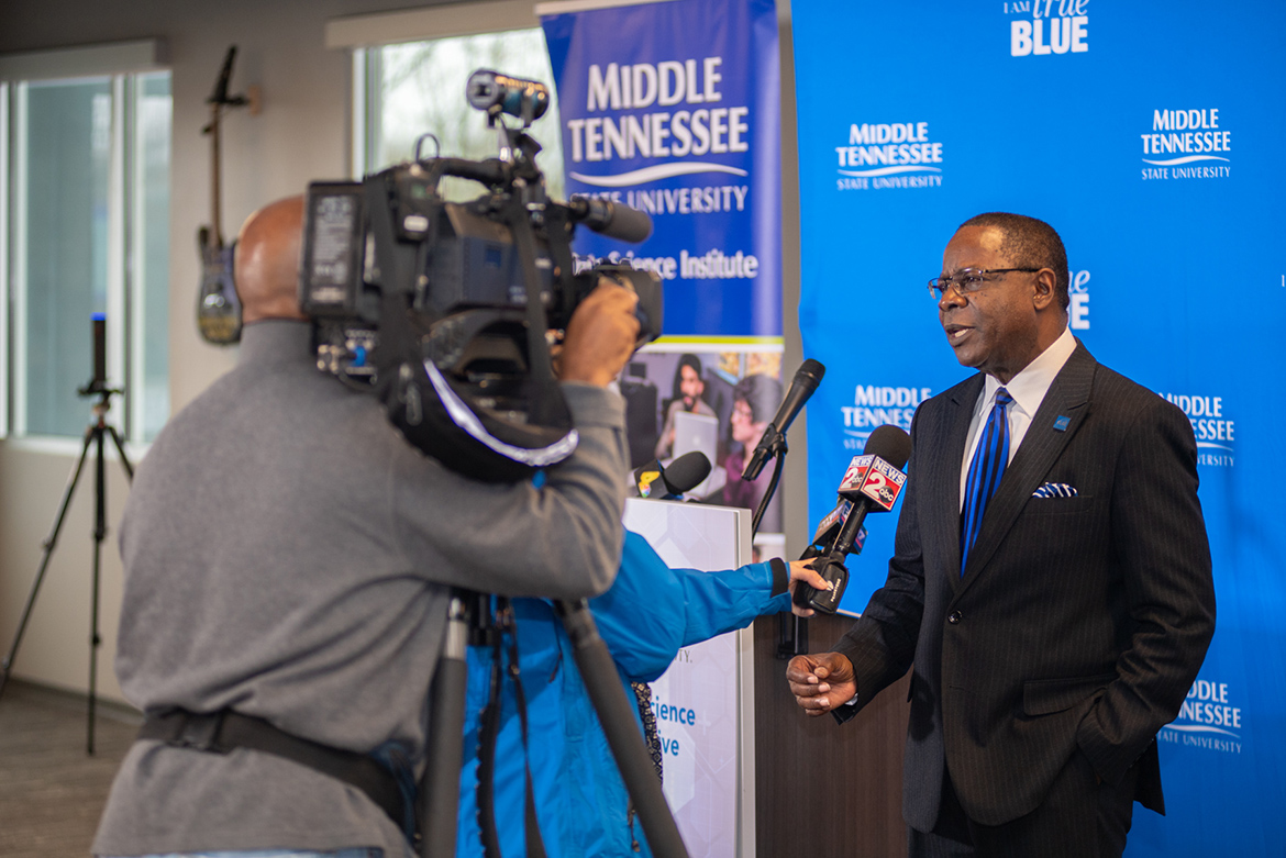 """MTSU President Sidney A. McPhee conducts an interview Tuesday, Feb. 18, with WKRN-TV News 2 at the university's kickoff of the Tennessee Data Initiative held at the Nashville Technology Council's headquarters. The initiative includes a new bachelor's degree in data science, a graduate certificate and pursuit of innovative programming and research project in the emerging field of """"big data."""" (MTSU photo by James Cessna)"""
