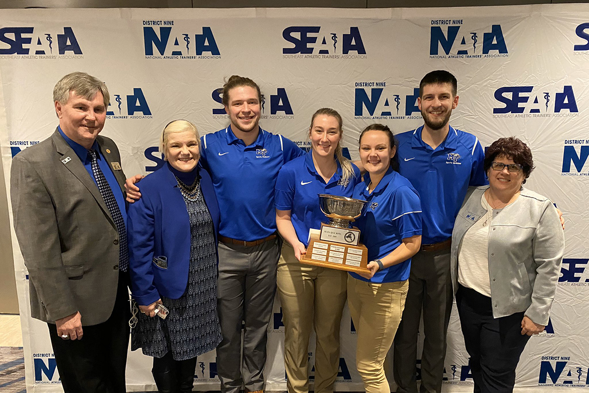 Members of the 2020 MTSU Quiz Bowl team pose with their first-place trophy and representatives of the Southeast Athletic Training Association at the regional organization's annual conference in Atlanta. From left, Gerard White, SEATA district nine director; Helen Binkley, associate professor of health and human performance and director of MTSU's athletic training program; senior Alex Turner from Brentwood, Tennessee; senior Bailey Griffin from Milton, Tennessee; sophomore Mary Tate from Humboldt, Tennessee; senior Andrew McAllister from Troy, Ohio; and Marisa Brunett, district nine president of SEATA. (Photo submitted)