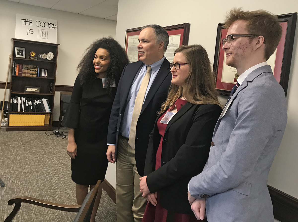 MTSU undergraduate student researchers pose for a photo with state Rep. Bryan Terry of Murfreesboro during the annual Posters at the Capitol visit Wednesday, Feb. 26, in Nashville, Tenn. From left are Tia Shutes, Kayley Stallings and Aric Moilanen. (MTSU photo by Randy Weiler)