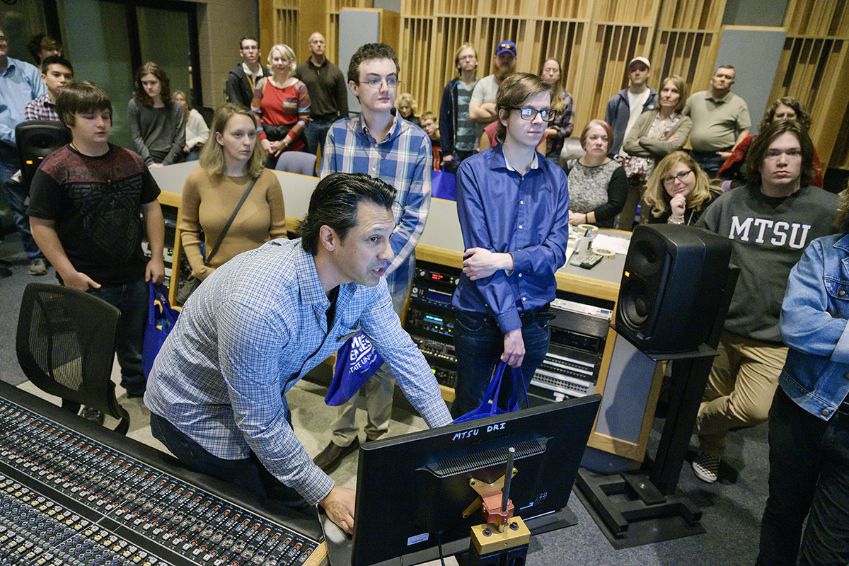 MTSU recording industry professor Matt Foglia, foreground, demonstrates to prospective students and their parents how the state-of-the-art equipment works in Studio A in the Bragg College of Media and Entertainment Monday, Feb. 17, as part of the Honors College Presidents Day Open House. Hundreds of students toured the campus and met various deans, faculty, department chairs and administrators. (MTSU photo by Andy Heidt)