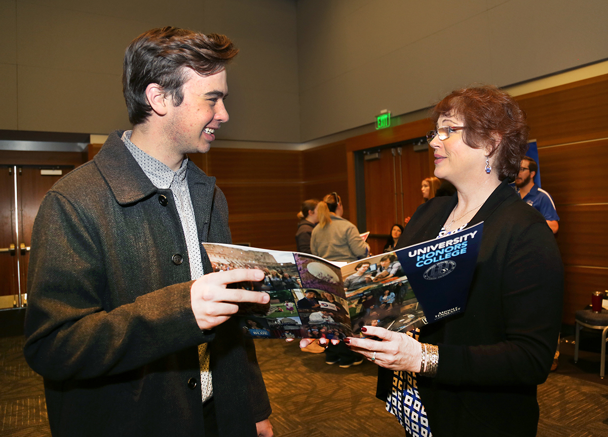 Ross Sibley, left, of Redlands, Calif., learns more about the MTSU Honors College from staff member Susan Lyons Monday, Feb. 17, in the Student Union Ballroom during the college's annual Presidents Day Open House. Sibley has been offered an Honors College Buchanan Fellow — the best scholarship MTSU offers a prospective student. (MTSU photo by Marsha Powers)