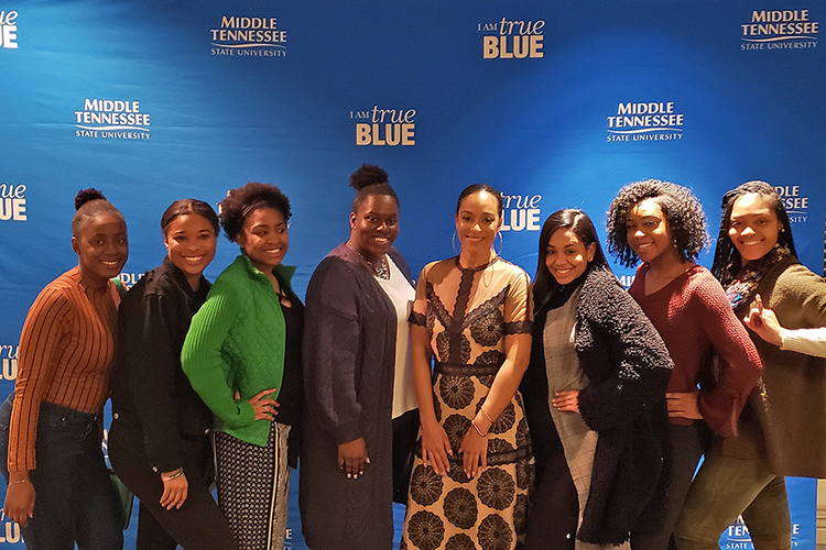 Washington, D.C.-based activist Angela Rye, fourth from right, takes a photo with a group of MTSU students following her MTSU Black History Month keynote address Feb. 26 in the Tennessee Room of the James Union Building. (MTSU photo by Jimmy Hart)