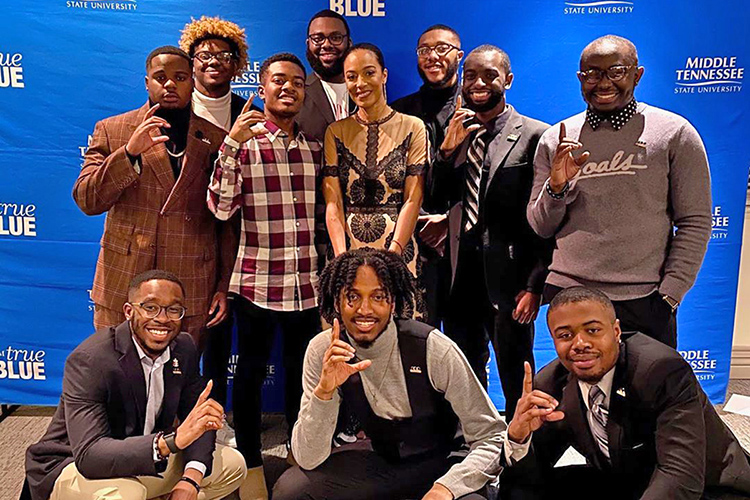Washington, D.C.-based activist Angela Rye, center, takes a photo with members of the Collegiate 100 student group following her MTSU Black History Month keynote address Feb. 26 in the Tennessee Room of the James Union Building. (Submitted photo)