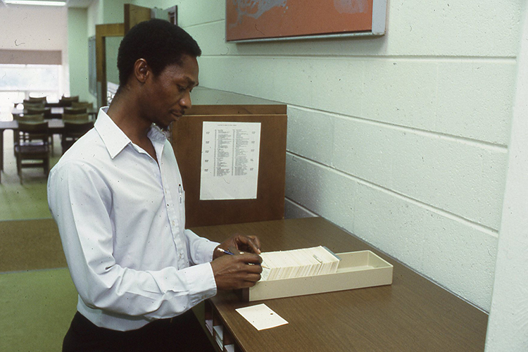 Momulu Massaquoi uses the card catalog in the Todd Library in this August 1990 file photo. (Photo submitted)