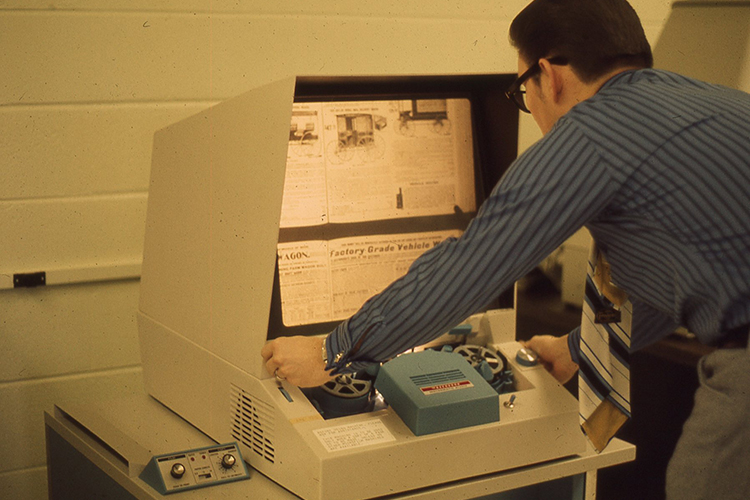 Library Dean Don Craig uses the microfilm reader in the Todd Library in this file photo from the 1980s. (Photo submitted)