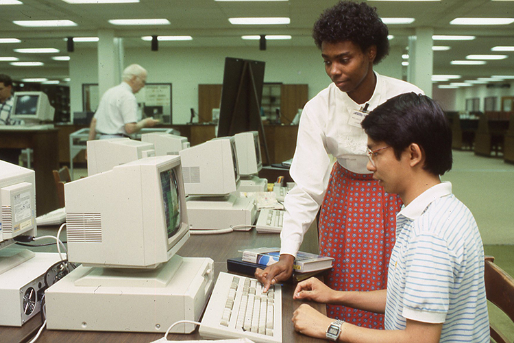 Library employee Melanie Thomas assists a student in the Todd Library's CD-ROM center in this 1987 file photo. (Photo submitted)