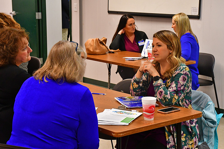MTSU University College representatives speak to a prospective students at the Finish Your Degree event held Feb. 6 at the D.W. Wilson Community Center in Tullahoma, Tenn. (MTSU photo by Hunter Patterson)