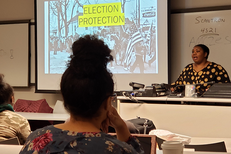 Voting rights organizer Armani Eady, right, discusses voting protections during a Feb. 11 public talk held at the Business and Aerospace Building. (MTSU photo by Jimmy Hart)