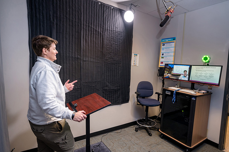 Finance professor Anne Anderson, Weatherford Chair of Finance, tapes a lecture for an online class in the Jones College of Business One Button Studio. (MTSU photo by J. Intintoli)