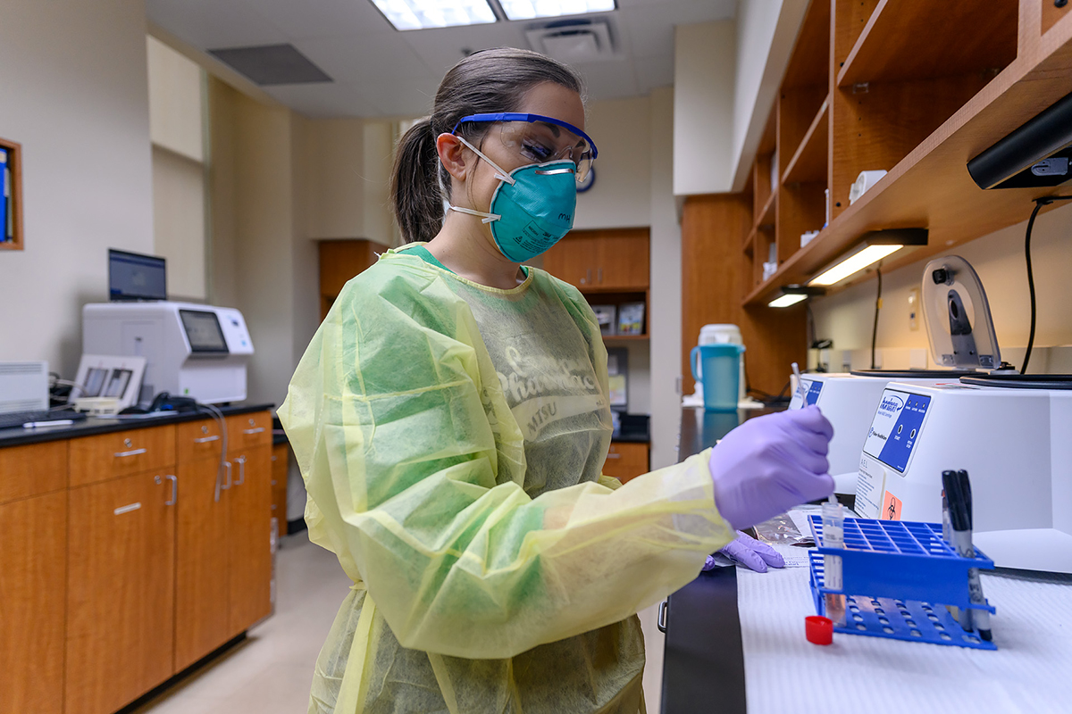 Megan Hollis, an X-ray and laboratory technician in MTSU Student Health Services, continues the lab work process for an MTSU student seen at the clinic Tuesday, March 17, in the Student Health, Wellness and Recreation Center. (MTSU photo by J. Intintoli)