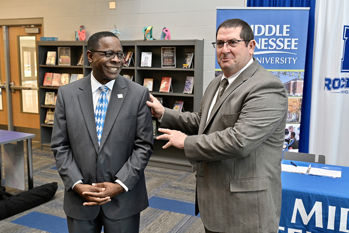"Rockvale High School Principal Steve Luker, right, tells a group of nearly 40 Rockvale students ""they can get a quality education (from MTSU) and not have to leave this county"" as MTSU President Sidney A. McPhee listens Thursday, March 5, during a partnership agreement signing announcement at the new school in Rockvale, Tenn.(MTSU photo by Andy Heidt)"