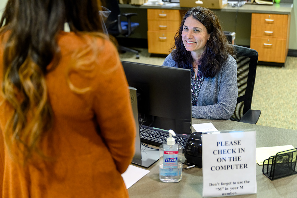 Kristy Carter, right, a secretary in MTSU Student Health Services, assists with the check-in of a student seeking care at the clinic Tuesday, March 17. The clinic is open from 8 a.m. to 4:30 p.m., with after-hours nursing assistance available by calling 615-898-2988. (MTSU photo by J. Intintoli)