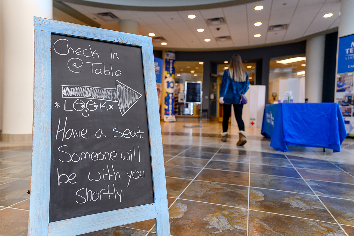 MTSU Student Health Services has implemented a triage area in the lobby of the Student Health Wellness and Recreation Center. Nurses will greet students, provide hand sanitizer, take their temperature and determine if upper respiratory issues might require the wearing of a mask. (MTSU photo by J. Intintoli)