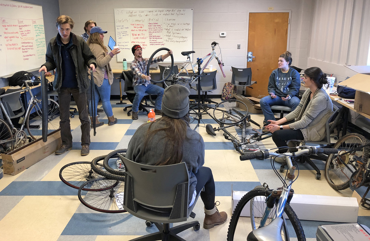 Members of the MTSU ag mechanics class work to repair bicycles they eventually donated to Murfreesboro nonprofit Greenhouse Ministries. (Submitted photo)