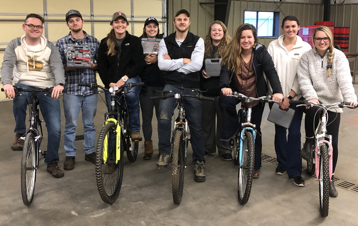 Hunter Holden, left, Blake Warmack, Madison Caudill, Abbey Taylor, Brendon Puckett, Taylor Bell, Lindsey Parsley, Sara Beth Martin and Jessie Hickerson Stand with the bicycles they repaired and donated to Murfreesboro's Greenhouse Ministries earlier this year. The bikes will help homeless people have transportation for jobs. One bicycle had welding issues. (Submitted photo)