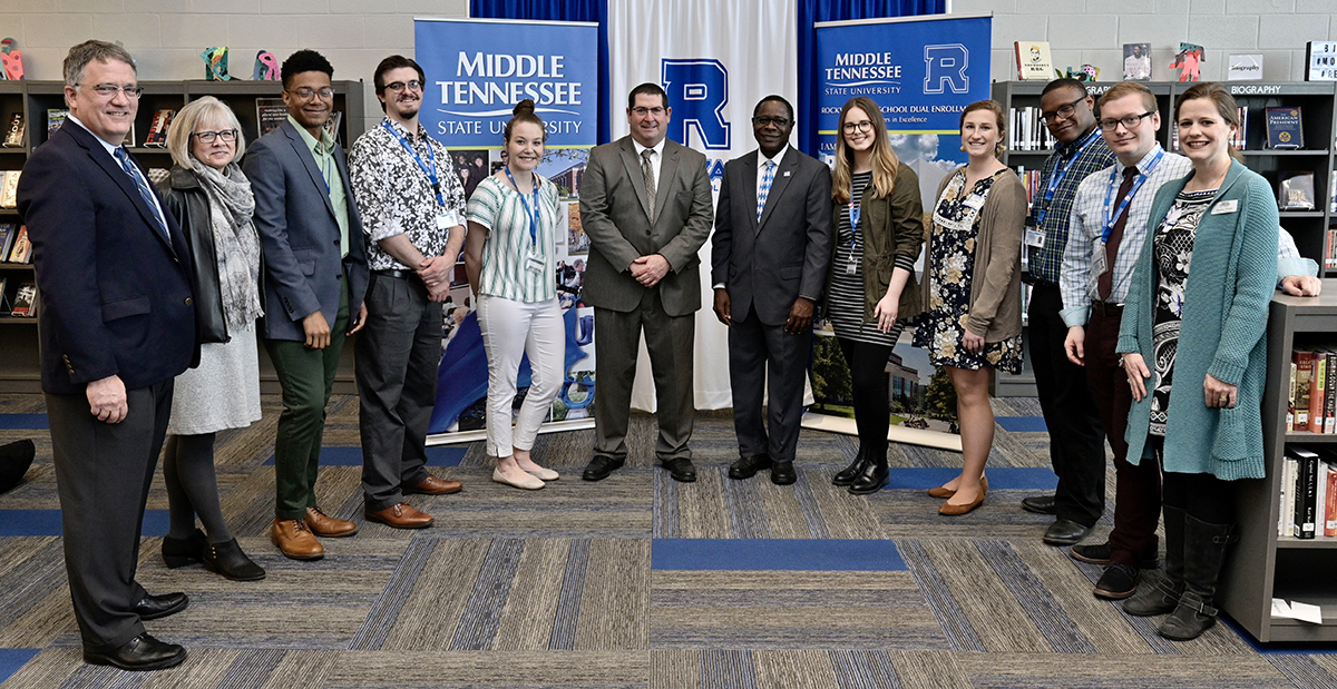 Seven MTSU student teachers working Thursday, March 5, at Rockvale High School attended the MTSU-Rockvale MOU agreement signing in the school library. They are shown with Provost Mark Byrnes, left, Student Affairs Vice President Deb Sells, Rockvale Principal Steve Luker and MTSU President Sidney A. McPhee, both center, and Heather Dillard, right, Womack Education Leadership associate professor, who directs the students' secondary education Residency I program. (MTSU photo by Andy Heidt)