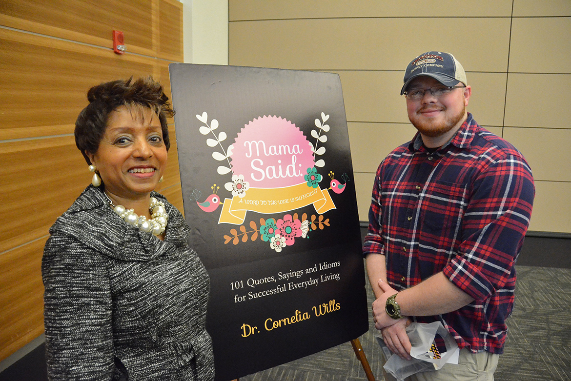 "MTSU Director of Student Success Dr. Cornelia Wills poses with MTSU freshman aerospace student Cole Sargent, right, after he purchased Wills' book at the ""Mama Said: A Word to the Wise is Sufficient"" book signing event Wednesday, March 4, in the MTSU Student Union Ballroom. (MTSU photo by Carl Coates Jr.)"