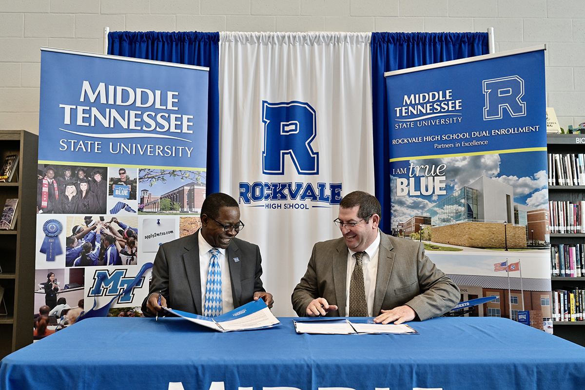 MTSU President Sidney A. McPhee, left, and Rockvale High School Principal Steve Luker smile as they sign documents cementing the dual enrollment partnership Thursday, March 5, at the first-year high school in Rockvale, Tenn. Forty-five students are taking dual enrollment classes this semester and the number should more than double in 2020-21. (MTSU photo by Andy Heidt)