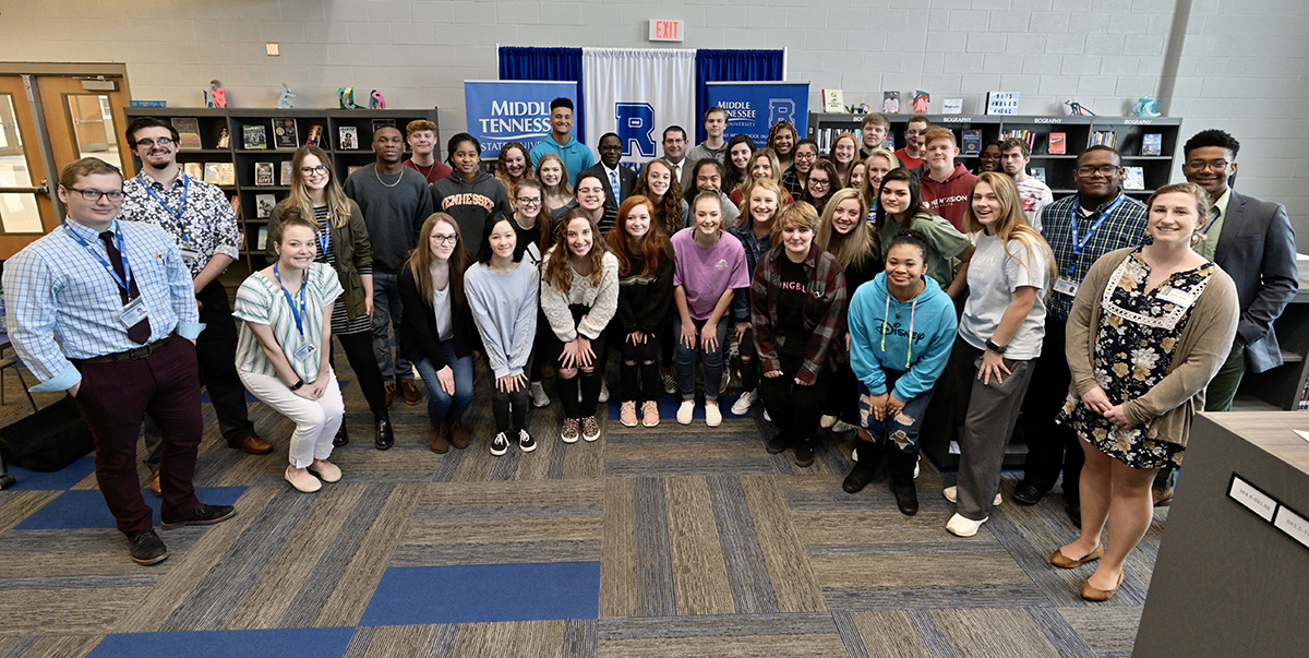 Nearly 40 Rockvale High School-MTSU dual enrollment students are shown with MTSU President Sidney A. McPhee and their principal, Steve Luker, following the MOU partnership signing in the school library Thursday, March 5, at the first-year high school in Rockvale, Tenn. (MTSU photo by Andy Heidt)