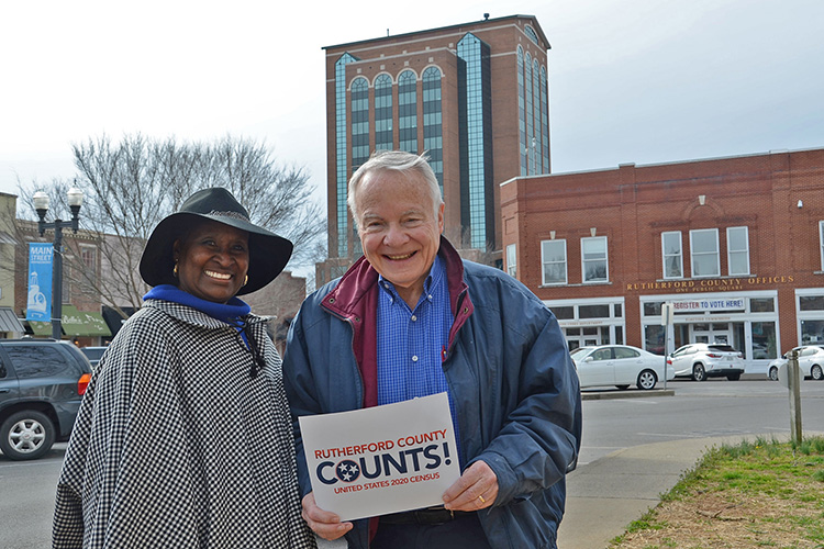 "Gloria Bonner, left, and Bill Kraus, co-chairs of the volunteer Rutherford County Complete Count Committee for the 2020 Census, pose with a ""Rutherford County Counts!"" placard outside the Rutherford County Courthouse in downtown Murfreesboro, Tenn. Residents have started receiving via mail their invitation to fill out the 2020 Census questionnaire. (Submitted photo)"