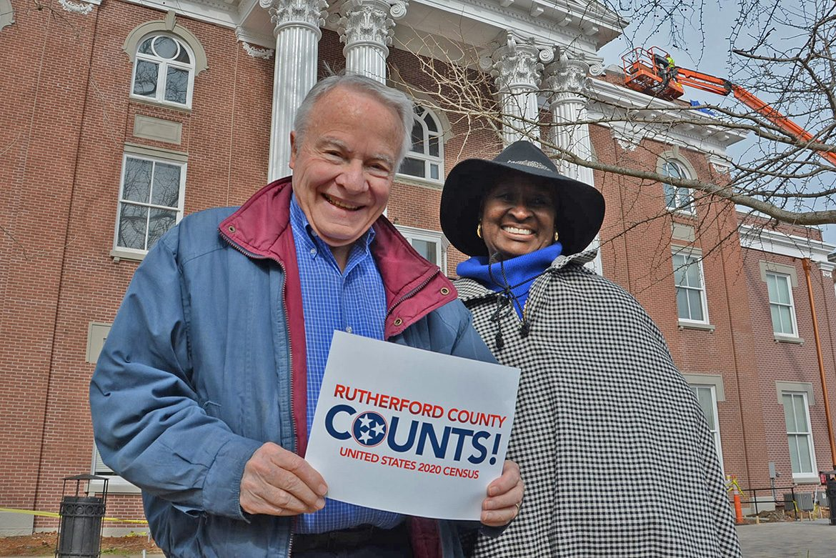 "Bill Kraus, left, and Gloria Bonner, co-chairs of the volunteer Rutherford County Complete Count Committee for the 2020 Census, pose with a ""Rutherford County Counts!"" placard outside the Rutherford County Courthouse in downtown Murfreesboro, Tenn. Residents have started receiving via mail their invitation to fill out the 2020 Census questionnaire. (Submitted photo)"