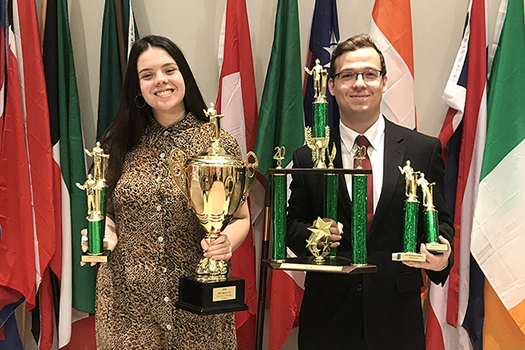 Anastasia Ortiz, left, a double major in biochemistry and political science from Gatlinburg, Tenn., and Graham Christophel, a sophomore international relations major from Morristown, Tenn., show off their awards March 1 at Arkansas Tech University's debate tournament. Ortiz was named second best speaker in the nation, and Ortiz and Christophel together were named second best team in the nation for the 2019-2020 season. (Photo submitted)