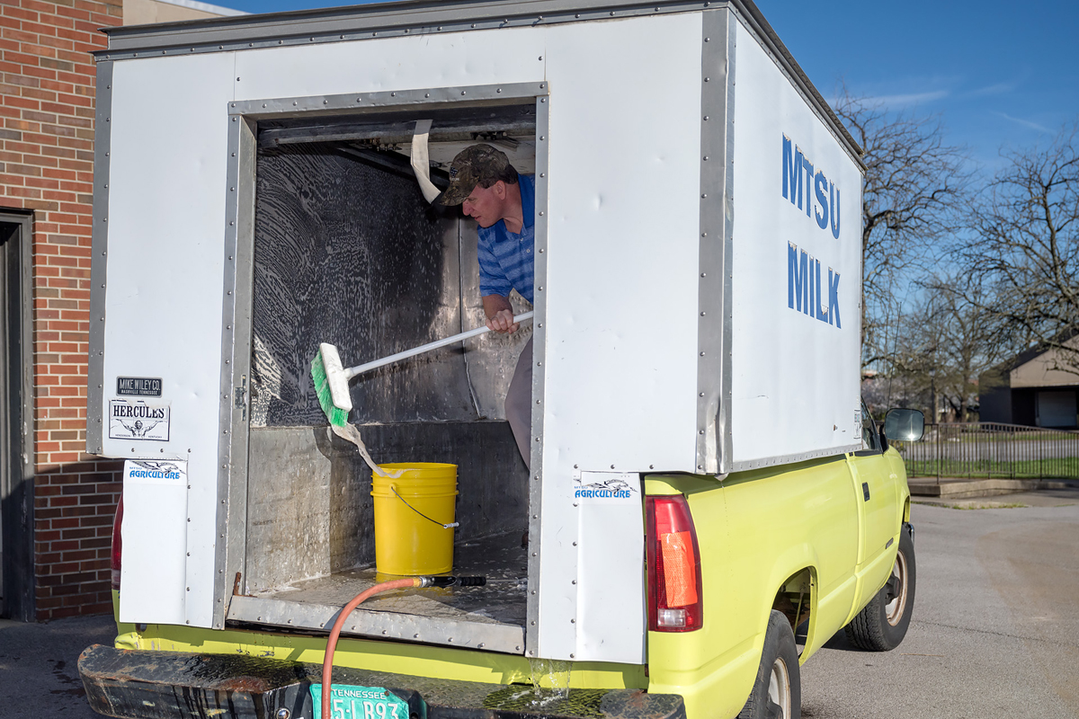 MTSU milk processing plant manager Steve Dixson cleans the delivery truck cooler before milk from the plant is brought on board and delivered to on- and off-campus venues. (MTSU photo by J. Intintoli)