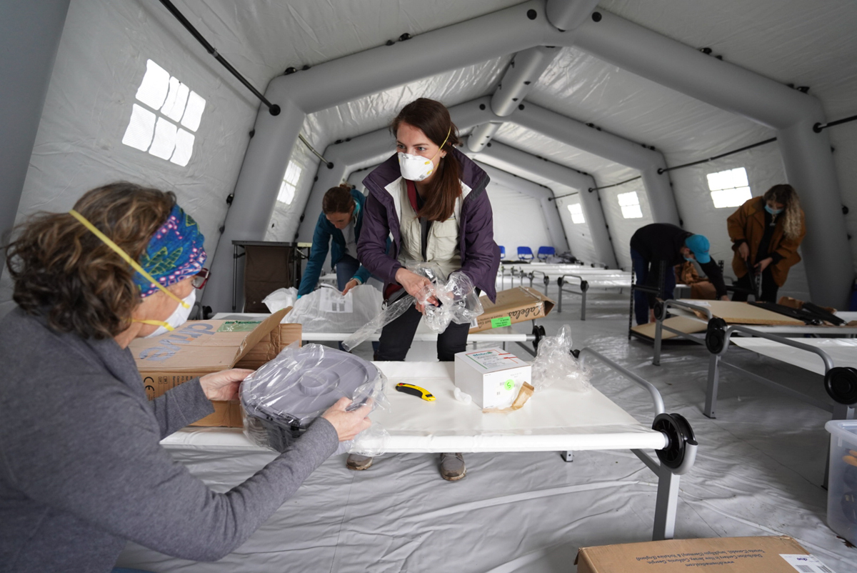 Nurses and Samaritan's Purse Staff ready the emergency field hospital in New York City's Central Park in preparation for the Tuesday, March 31, opening to accept coronavirus COVID-19 patients. (Courtesy of Samaritan's Purse/photo by Paul Sherar)