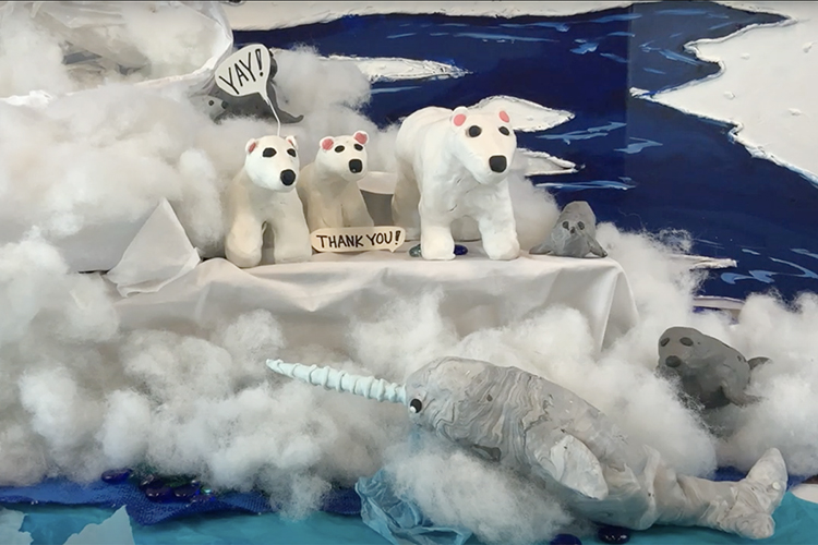 """Happy Arctic animals, including polar bears, seals and a narwhal, celebrate their cleaner habitat in this frame from """"Arctic Blues,"""" a one-minute stop-motion animated video created by students from the Tennessee School for the Blind in Nashville and MTSU art education students. The video, one of more than 22,000 entries from 78 countries this spring in the 48th International Children's Exhibition of Fine Arts Lidice competition, earned an honorable mention. (Photo from """"Arctic Blues"""" video)"""