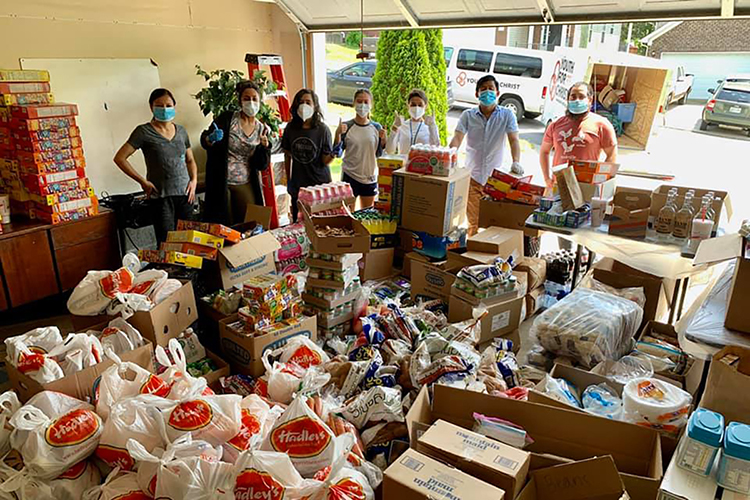Volunteers with BRAVE Nashville survey food, cleaning products and other items donated to their organization to help the Bhutanese/Nepalese community in Nashville survive the COVID-19 pandemic. (Image submitted)
