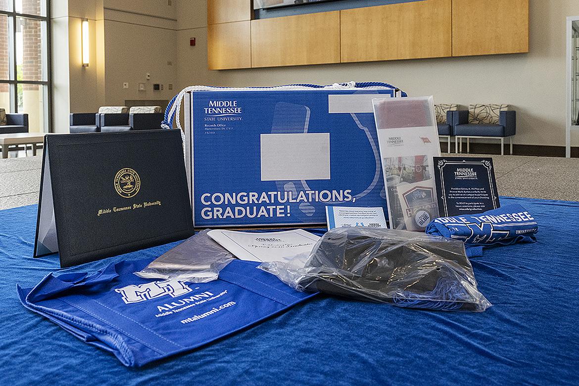 "A display in the lobby of MTSU's Student Services and Admissions Center shows the contents of the ""True Blue Graduation Box,"" which includes a diploma, special tassel and other gifts. The boxes are being provided for summer 2020 graduates after MTSU canceled its traditional commencement ceremonies at Murphy Center for a second time because of the COVID-19 pandemic. The university is conducting a virtual commencement ceremony on Saturday, Aug. 8. (MTSU file photo by Andy Heidt)"