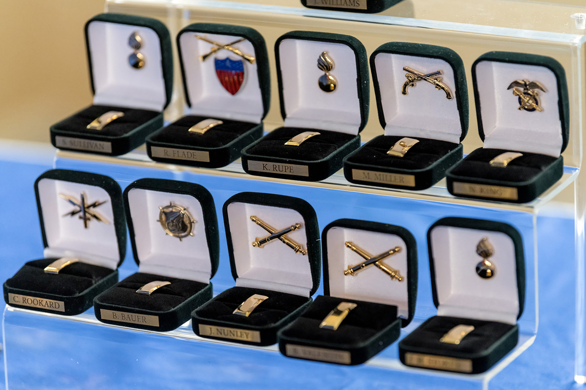 Several rows of military pins were on display in the Tom H. Jackson Building's Cantrell Hall Friday, May 8, as the first of 13 ROTC commissioning ceremonies began. Graduating senior cadets were commissioned as second lieutenants. (MTSU photo by J. Intintoli)