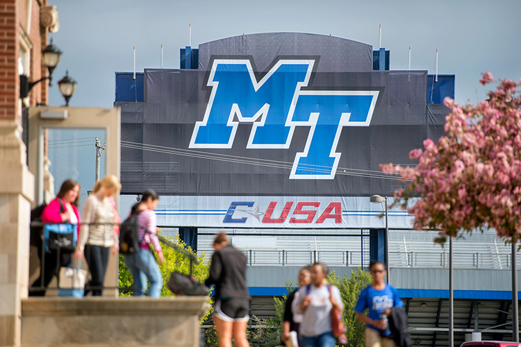 With Floyd Stadium in the background, students enter and exit Kirksey Old Main in this file campus photo. An MTSU task force has released recommendations for bringing students back to campus for in-person classes in some capacity for the Fall 2020 semester. (MTSU file photo by J. Intintoli)