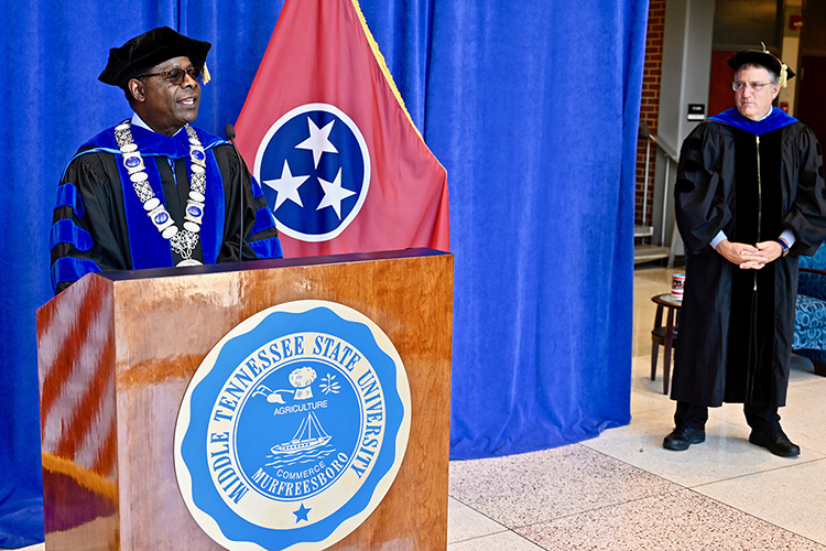MTSU President Sidney A. McPhee, left, prepares to introduce university Provost Mark Byrnes, right, to present spring 2020 degree candidates inside the lobby of the university's Cope Administration Building while they tape MTSU's virtual commencement ceremony to air Saturday, May 9. MTSU formally presented 2,519 students with degrees in an online event arranged to celebrate their accomplishments during the pandemic. (MTSU photo by Andrew Oppmann)